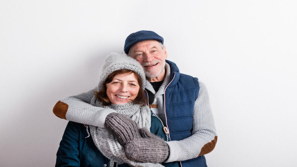 picture of seniors wearing gloves, scarf and hats